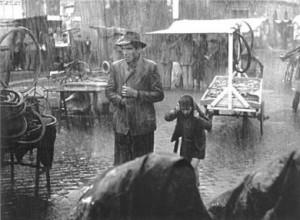 Ladri di biciclette. Padre e figlio sotto la pioggia