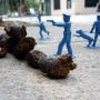 merde di cane sporcano le città