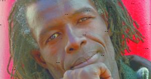Mohamed Ba, attore e musicista senegalese, accoltellato nel maggio 2009 a Milano.