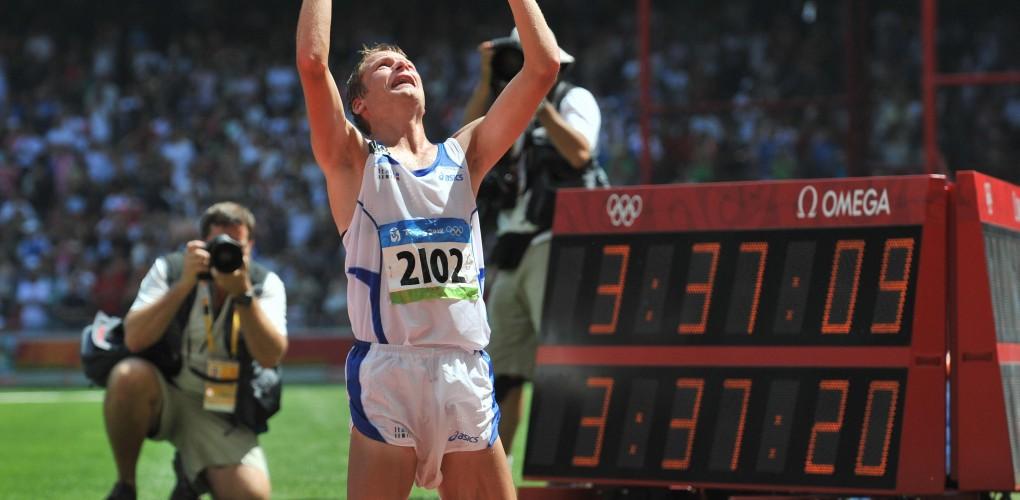 Alex Schwazer of Italy celebrates as he