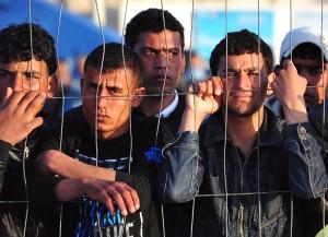 Tunisian migrants wait for the arrival o