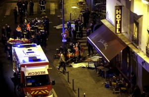 General view of the scene with rescue service personnel working near covered bodies outside a restaurant following shooting incidents in Paris, France