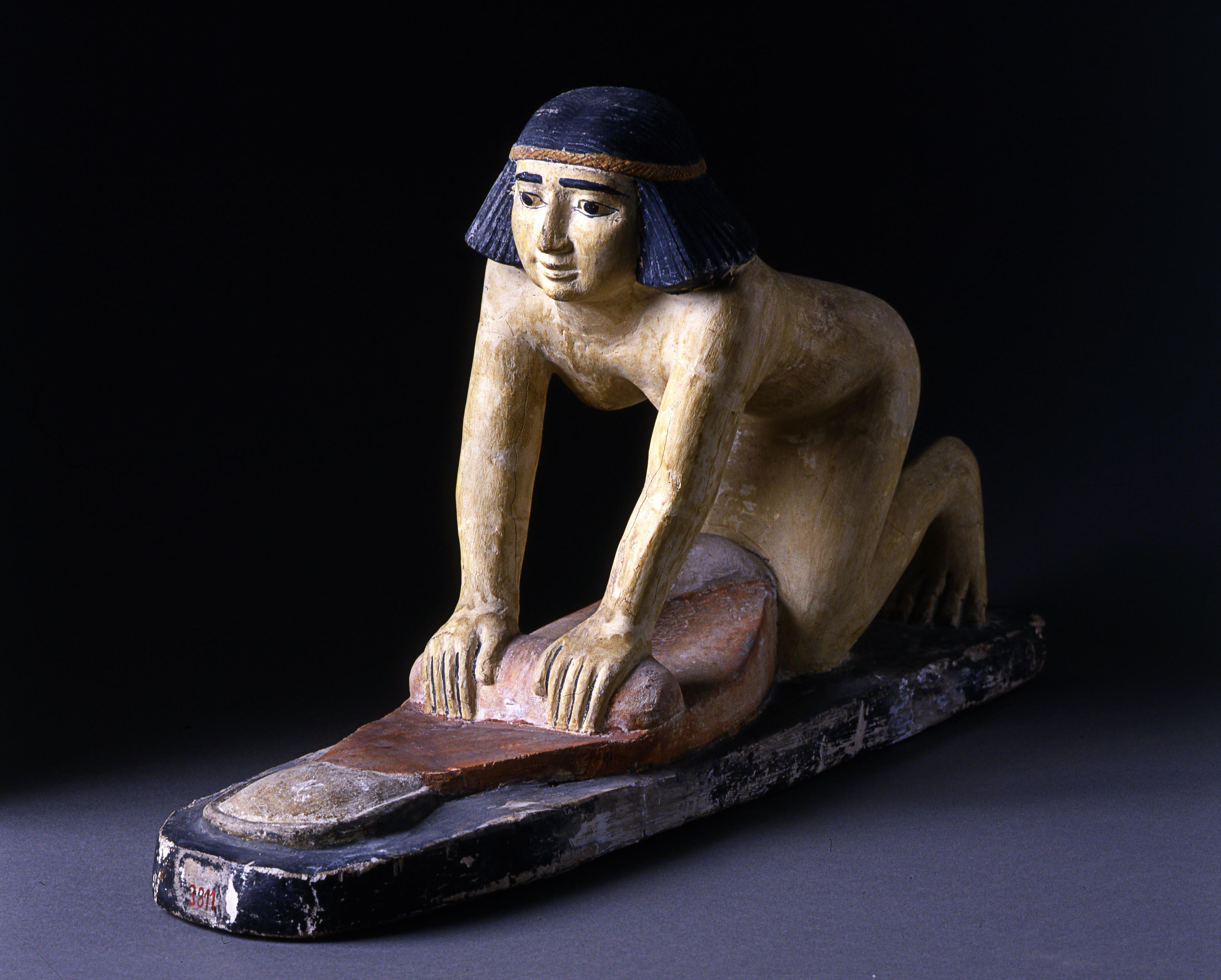 Statuetta di donna  egiziana che prepara il pane